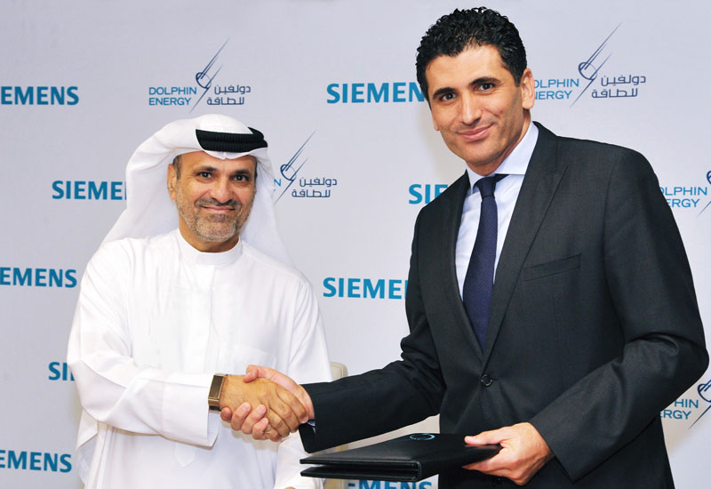 Adel Ahmed Albuainain, CEO of Dolphin Energy, and Fatih Sakiz, CEO Siemens Qatar.