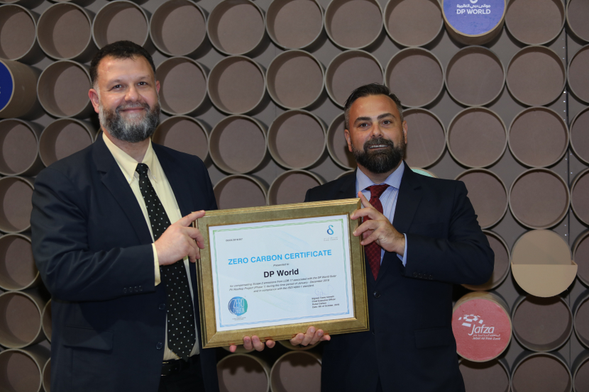 CEO of Dubai Carbon, Ivano Iannelli, awards certificate of Net Zero Carbon Emissions, VP Group Health, Safety and Environment of  DP World, Nabil Battal at the 20th Water, Energy, Technology and Environment Exhibition (WETEX) at Dubai World Trade Centre.