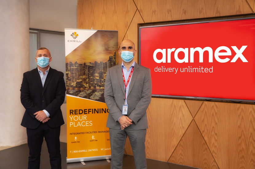 (from left): Stuart Harrison, Emrill's CEO; Ahmed Marie, general manager of Aramex.